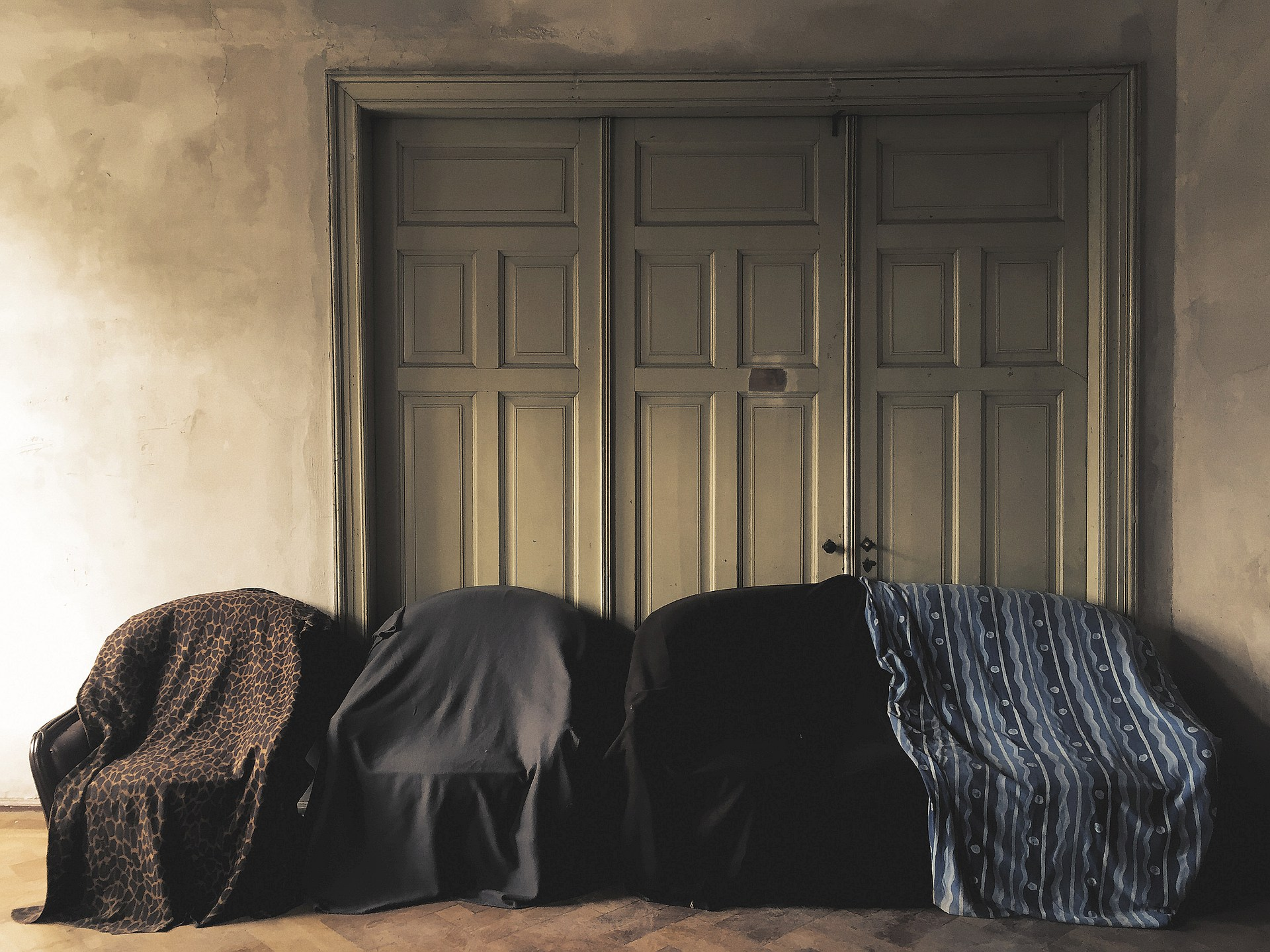 Four covered armchairs